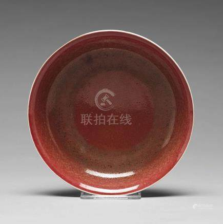 A peachbloom dish, Qing dynasty, 18th Century with Xuande mark.