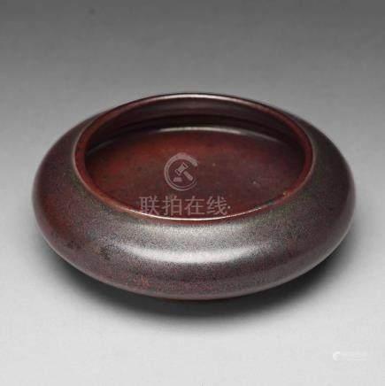 A iron dust glazed brush washer, Qing dynasty, 18th Century.