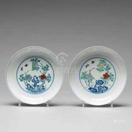 A pair of 'butterfly and peonies' dishes, Qing dynasty with Yongzheng mark.