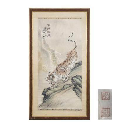 CHINE, XXème siècle. Encre sur papier représentant un tigre tapis sur un rocher