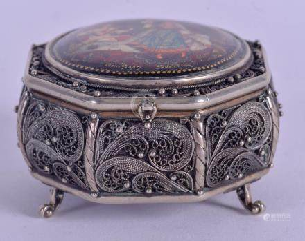 AN UNUSUAL RUSSIAN SILVER AND BLACK LACQUER BOX painted with romantic figures. 100 grams. 6 cm wide