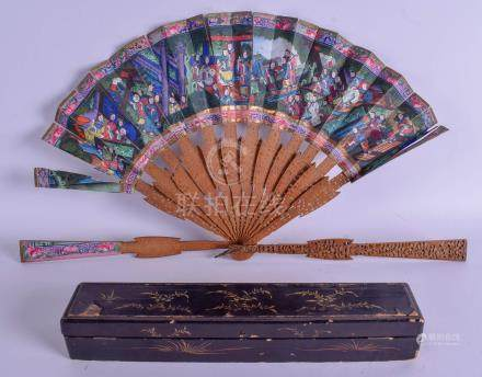 A RARE 19TH CENTURY CHINESE SANDALWOOD PAINTED IVORY FAN decorated with figures within landscapes.