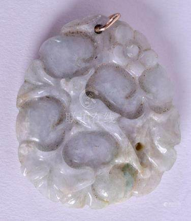 AN EARLY 20TH CENTURY CHINESE CARVED JADEITE PENDANT. 3.5 cm x 3.5 cm.