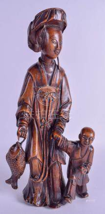 A 19TH CENTURY CHINESE CARVED HARDWOOD FIGURE OF A FEMALE modelled holding a child's hands. 35 cm h