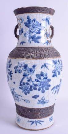 A LARGE 19TH CENTURY CHINESE CRACKLE GLAZED BLUE AND WHITE VASE painted with birds and foliage. 43.