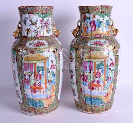 A RARE PAIR OF 19TH CENTURY CHINESE CANTON FAMILLE ROSE RIBBED VASES Qing. 36 cm high.