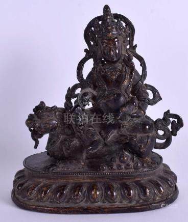A 19TH CENTURY CHINESE TIBETAN BRONZE FIGURE OF A BUDDHA modelled seated upon a Buddhistic lion. 21