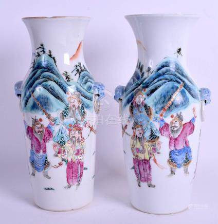 A PAIR OF 19TH CENTURY CHINESE FAMILLE ROSE VASES Qing, painted with figures on horseback. 23.5 cm