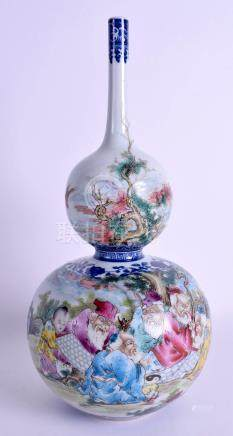 A CHINESE DOUBLE GOURD PORCELAIN VASE 20th Century, painted with famille rose enamelled figures wit