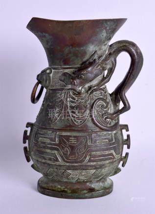 A RARE 18TH CENTURY CHINESE BRONZE ARCHAISTIC EWER Qianlong, decorated with mask heads. 21 cm x 12