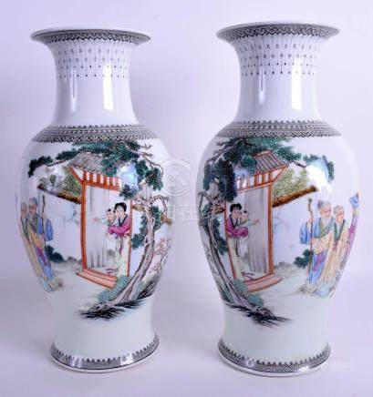 A PAIR OF CHINESE REPUBLICAN PERIOD VASES painted with figures within landscapes. 36 cm high.