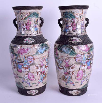 A PAIR OF 19TH CENTURY CHINESE FAMILLE ROSE CRACKLE GLAZED VASES painted with warriors. 36 cm high.