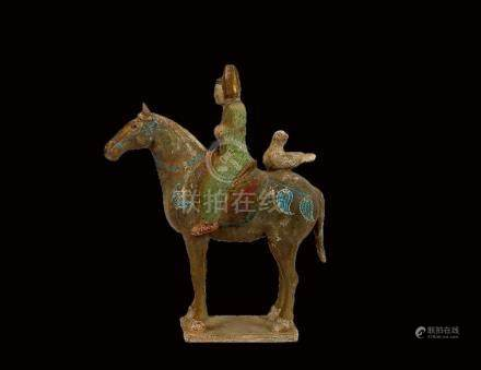 A Painted and Gilded Red Pottery Horse and Male Rider