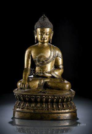 A FINE SILVER-INLAID BRONZE FIGURE OF BUDDHA SHAKYAMUNI, Western or Central Tibet, 15th ct., seated