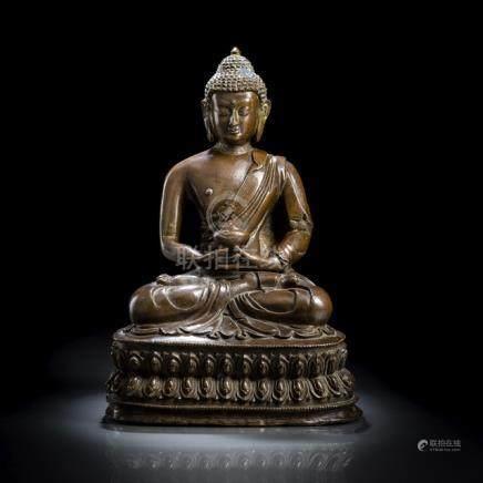 A BRONZE FIGURE OF BUDDHA SHAKYAMUNI, TIBET,ca. 18th/19th ct., seated in vajrasana on a lotus base w