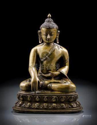 A BRONZE FIGURE OF BUDDHA SHAKYAMUNI, Tibet, 15th ct., seated in vajrasana on a lotus base with his