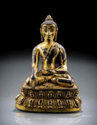 A GILT-BRONZE FIGURE OF BUDDHA AKSHOBYA, Tibet, 15th ct., seated in vajrasana on a lotus base with t