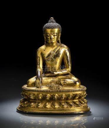 A FINE GILT-BRONZE FIGURE OF BUDDHA AKSHOBYA, Tibet, 15th ct., seated in vajrasana on a lotus base w
