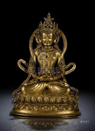 A GILT-BRONZE FIGURE OF AMITAYUS, TIBET, 16th ct., seated in vajrasana on a lotus base with both han