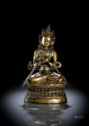 A SILVER-INLAID BRONZE FIGURE OF VAJRADHARA, TIBET, 15th/16th ct., seated in vajrasana on a lotus ba