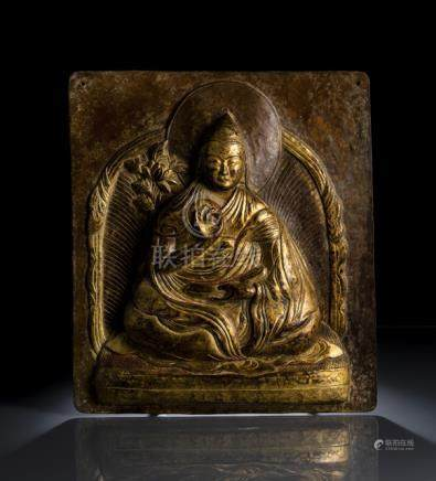 A GILT-COPPER PLAQUE EMBOSSED WITH A LAMA, TIBET, ca. 17th ct., the rectangular plaque is embossed i