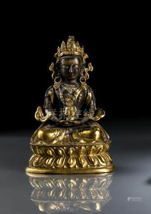 A PARCEL GILT-BRONZE FIGURE OF AMITAYUS, TIBETO-CHINESE, 18th ct., seated in vajrasana on a lotus ba