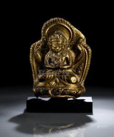 A GILT-COPPER PLAQUE EMBOSSED WITH SADAKSHARILOKESHVARA, Tibet, 18th ct., on wood base. The plaque i