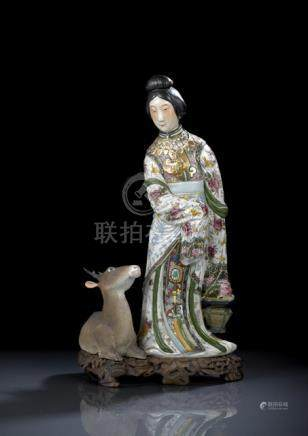 A POLYCHROME PAINTED PORCELAIN MODEL OF STANDING MAGU AND A DEER ON A WOOD STAND, China, marked huna