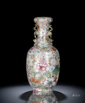 A GOOD MILLE FLEUR PORCELAIN VASE WITH FRUIT HANDLES, China, Qianlong six-character seal mark in iro