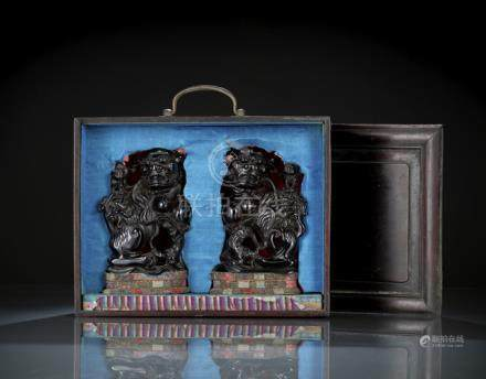 A PAIR OF AMBER-COLORED BUDDHIST LION PAIR WITH WOODEN BOX, China, Republic period - Property from t