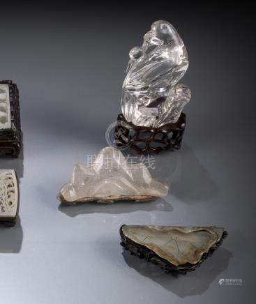 A CARVED JADE LOTOS LEAF, A GLASS BRUSHREST, A CARVED CRYSTAL BIRD AND A SOAPSTONE STAND, two with c