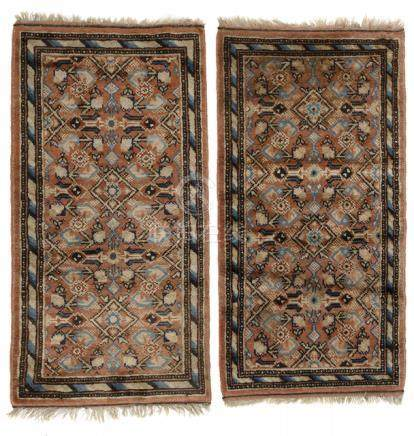 A PAIR OF KHOTAN-STYLE WOOL CARPETS, China, late Qing/Republic period - Property from the collection