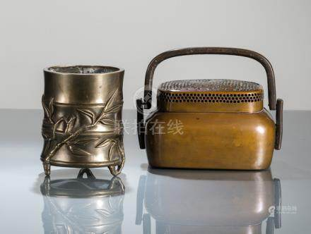 A COPPER HAND WARMER WITH PIERCED COVER AND A BRONZE BAMBOO SHAPED BRUSH POT, China, Qing dynasty -