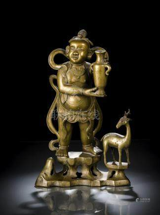 A BRONZE FIGURE OF A YOUNG BOY AS INKSTICK HOLDER, CHINA, Qing dynasty, standing with legs slightly
