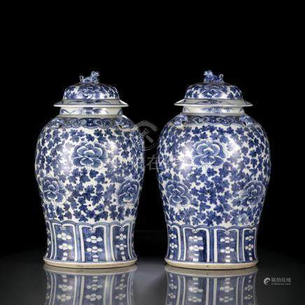 A PAIR OF BLUE AND WHITE FLORAL VASES AND COVERS, China, 19th ct. - Very short hairline crack at the