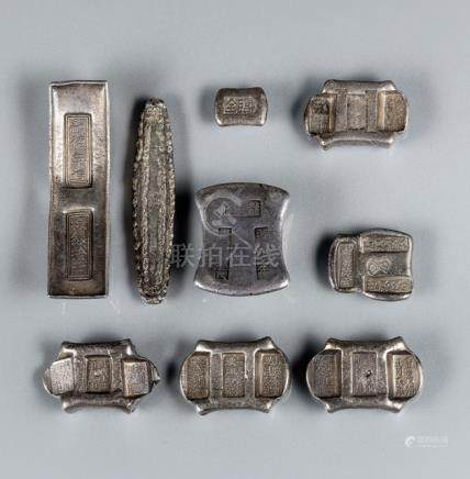 A GROUP OF NINE MARKED SILVER BARS, China, Qing dynasty: one dated 1823, one Vietnamese Tu-Duc perio