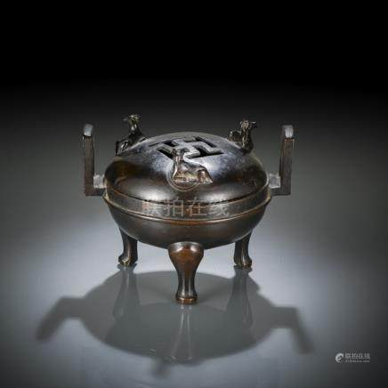 A DING-SHAPED BRONZE CENSER AND COVER WITH RAM HANDLES, China, Ming/early Qing dynasty - Minor wear,