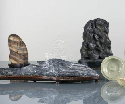 A GROUP OF FOUR SCHOLAR'S ROCKS ON WOOD BASES, China/Japan - Partly chipped