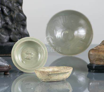 TWO CELADON BOWLS AND AN EARCUP, China, Yuan/Qing dynasty, one bowl with fish in relief, the other w