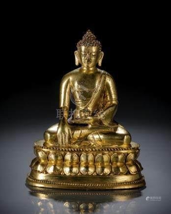 A GILT-BRONZE FIGURE OF BUDDHA SHAKYAMUNI, TIBET, 18th ct., seated in vajrasana on a lotus base with