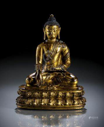 A GILT-BRONZE FIGURE OF BUDDHA SHAKYAMUNI, Tibet, 15th ct., seated in vajrasana on a lotus base set