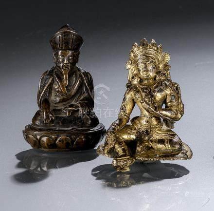 A GILT-BRONZE FIGURE OF SYAMATARA AND A BRONZE FIGURE OF A LAMA, TIBET, 17th/18th ct., Syamatara is