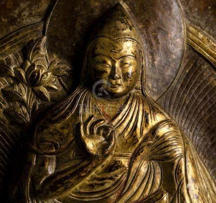 A BRONZE FIGURE OF VAJRADHARA, TIBET, 15th ct., seated in vajrasana on a lotus base with both hands