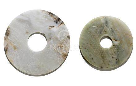 TWO 'BI' DISCS WITH STYLIZED PHOENIX AND ABSTRACT ''TAOTIE' DECOR, China, Western Han dynasty and Mi
