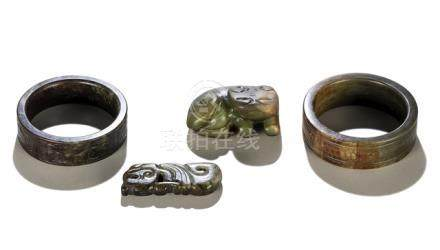 A JADE PENDANT, TWO JADE BRACELETS WITH ANIMAL AND HONEYCOMB DECOR  AND JADE CARVING OF A HORNED BEA