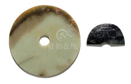 A JADE BI DISC AND A TAOTIE DECORATED JADE PENDANT IN ARCHAIC STYLE, China, Ming dynasty or earlier