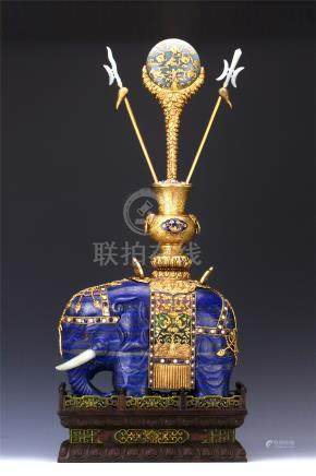 CHINESE LAPIS ELEPHANT WITH JADE INLAID GILT BRONZE ENAMEL VASE AND AGALWOOD BASE
