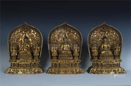 THREE TIBETAN GILT BRONZE SEATED BUDDHA WITH NICHE AND BASE QING DYNASTY