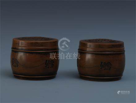PAIR OF CHINESE YIXING ZISHA CLAY LIDDED JARS
