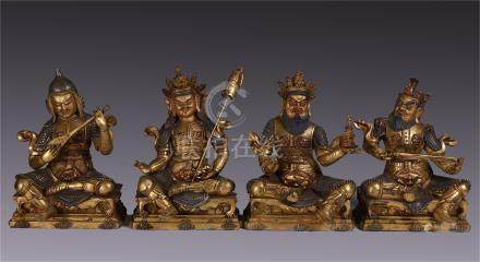 CHINESE GILT BRONZE SEATED FOUR HEAVENLY KINGS WITH WEAPONS